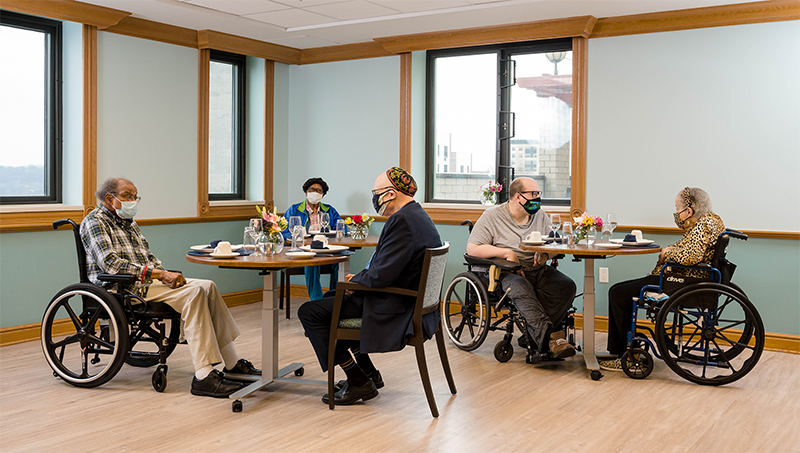 Residents enjoying a meal in the main Dining Room